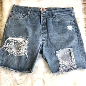 LEVIS.  Distressed raw hem 501 denim shorts